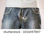 lightbulb out of mens jeans... | Shutterstock . vector #1016457847