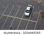 lonely silver car in an empty... | Shutterstock . vector #1016469265