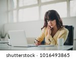 bussinesswoman reading email at ... | Shutterstock . vector #1016493865