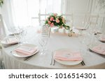 cutlery stands on a white round ... | Shutterstock . vector #1016514301