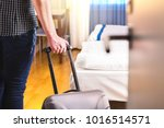 man pulling suitcase and... | Shutterstock . vector #1016514571