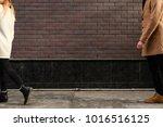 couple breakup. girl leaving....   Shutterstock . vector #1016516125