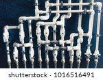 white plastic pipes in boiler... | Shutterstock . vector #1016516491