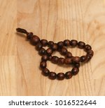 wooden rosary for meditation | Shutterstock . vector #1016522644