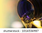 liquid stream of motor oil... | Shutterstock . vector #1016536987