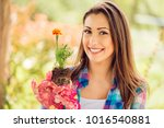 portrait of a smiling young... | Shutterstock . vector #1016540881