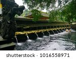 tirta empul temple  holy spring ...   Shutterstock . vector #1016558971