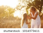 family  mother and daughter are ... | Shutterstock . vector #1016573611