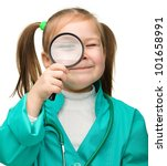 Cute little girl is playing doctor looking through magnifier, isolated over white - stock photo