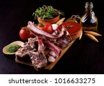 heap of raw lamb ribs with... | Shutterstock . vector #1016633275