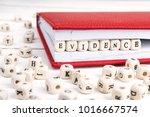 word evidence written in wooden ...   Shutterstock . vector #1016667574