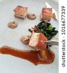 crispy but tender suckling pig... | Shutterstock . vector #1016677339