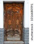 an ancient wooden front door... | Shutterstock . vector #1016680591