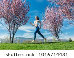 woman running for fitness on a... | Shutterstock . vector #1016714431