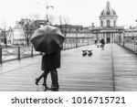 Couple Under The Rain On The...