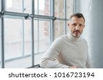 serious stylish middle aged man ... | Shutterstock . vector #1016723194