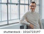 smiling attractive mature man... | Shutterstock . vector #1016723197