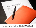 Small photo of Job description and golden pen on the envelope for letters