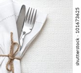 knife and fork with white linen ...   Shutterstock . vector #101673625