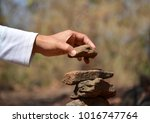 women's hand stacked stone. | Shutterstock . vector #1016747764