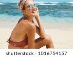 content restful female tourist... | Shutterstock . vector #1016754157