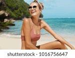 young happy female wears... | Shutterstock . vector #1016756647