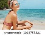 joyful female wears bikini ... | Shutterstock . vector #1016758321