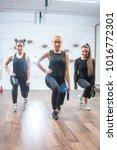 three sportswomen doing squat...   Shutterstock . vector #1016772301