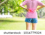 woman back pain on natural... | Shutterstock . vector #1016779324