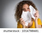 Small photo of Woman tearing paper, Young woman in a yellow t-shirt with torn paper