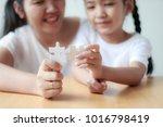 asian little girl playing... | Shutterstock . vector #1016798419