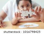 asian little girl playing... | Shutterstock . vector #1016798425