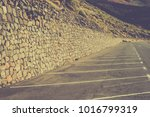 empty car parking lines in the... | Shutterstock . vector #1016799319