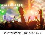 crowd of hands up concert stage ... | Shutterstock . vector #1016801629