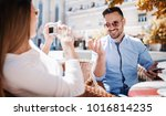 dating in the cafe. beautiful... | Shutterstock . vector #1016814235