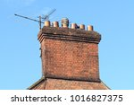 chimney stack and tv aerial on... | Shutterstock . vector #1016827375