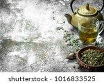 green tea with a teapot. on a...   Shutterstock . vector #1016833525