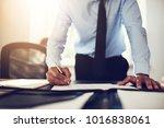 mature lawyer wearing a shirt... | Shutterstock . vector #1016838061