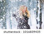 winter young teen girl portrait.... | Shutterstock . vector #1016839435