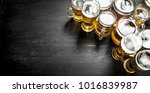 glasses with beer. on the black ... | Shutterstock . vector #1016839987