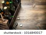 box of fresh beer. on a wooden... | Shutterstock . vector #1016840017