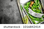 green peas with an old knife.... | Shutterstock . vector #1016842414