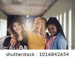 laughing group of diverse young ... | Shutterstock . vector #1016842654