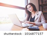 young asian women with laptop... | Shutterstock . vector #1016877157