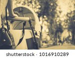 mother with a stroller on a walk | Shutterstock . vector #1016910289
