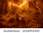 Small photo of Dramatic religious background - hell realm, bright lightnings in dark red apocalyptic sky, judgement day, end of world, eternal damnation