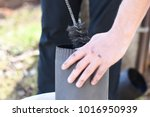 man cleaning chimney pipe... | Shutterstock . vector #1016950939