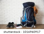 traveler's backpack with hat... | Shutterstock . vector #1016960917