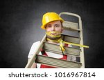Small photo of Clumsy worker with measure tape