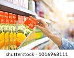 woman hand choosing to buy... | Shutterstock . vector #1016968111